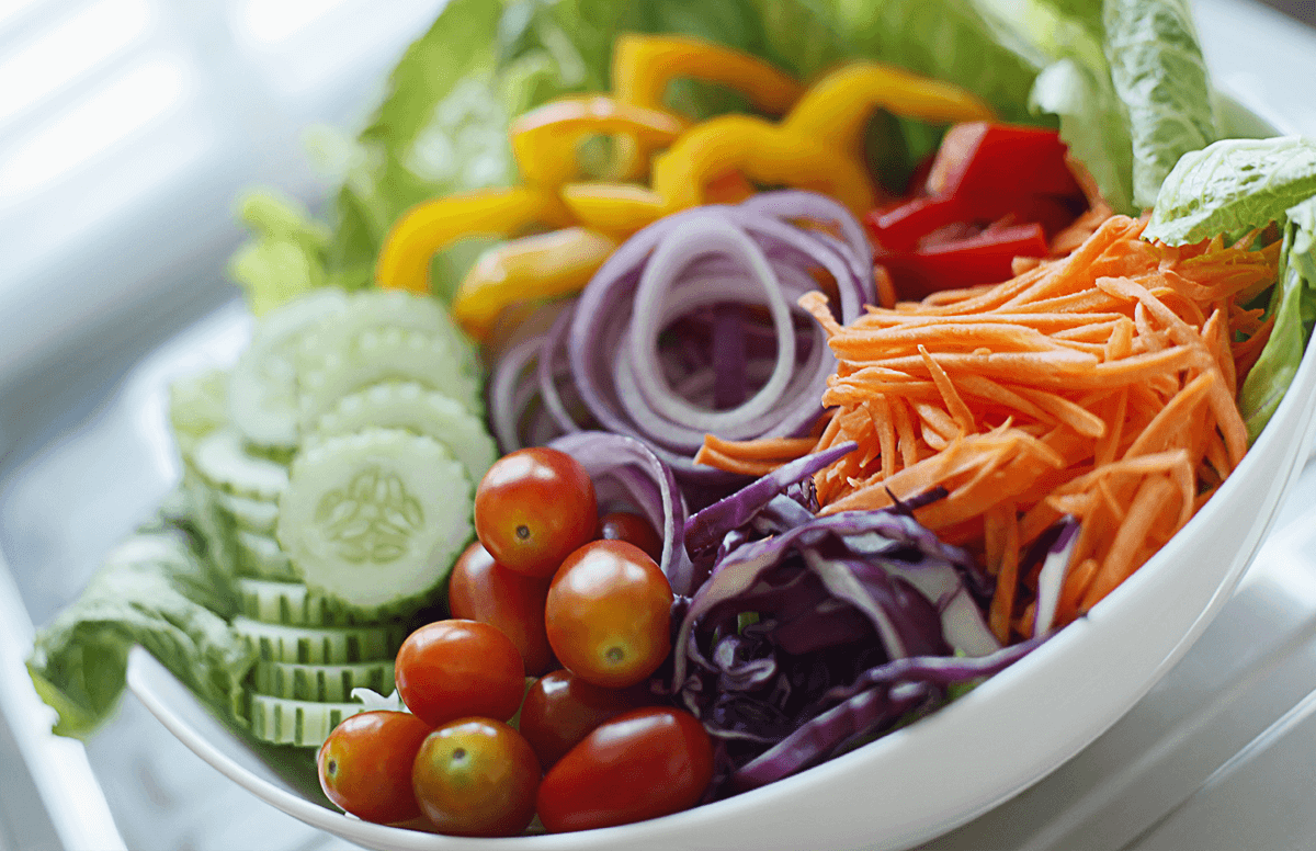 A bowl of vibrant salad ingredients